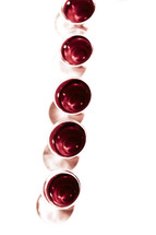 A row of communion cups isolated on white