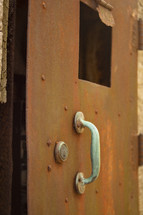 handle on a rusty metal door