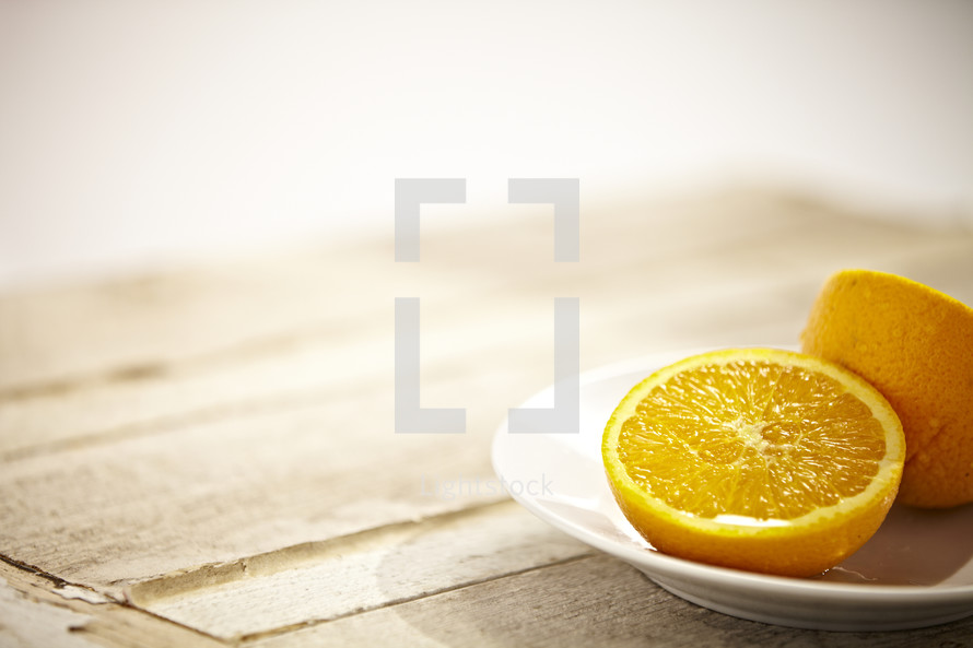 Two halves of an orange on a plate