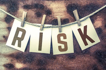 word risk on a clothesline