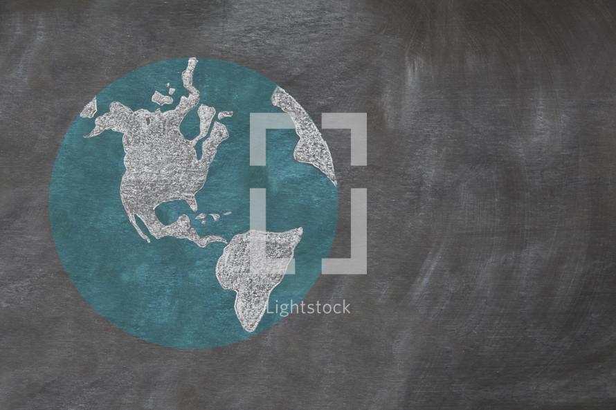 Drawing of planet earth on chalkboard.