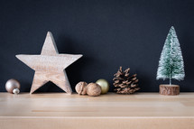 star, pine cone, and bottle brush Christmas tree