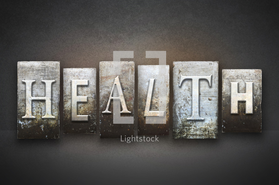 Stone tiles spelling the word HEALTH.