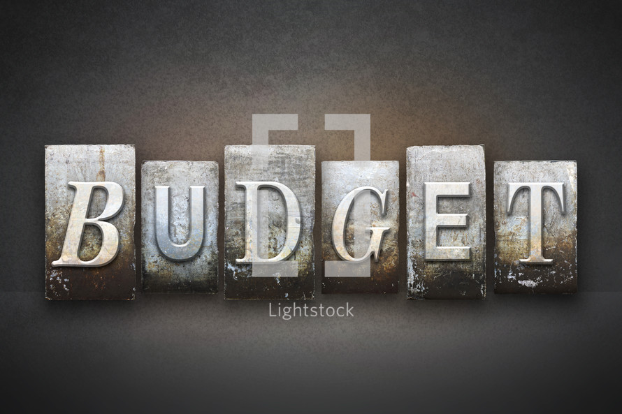 Stone tiles spelling the word BUDGET.