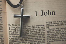 1 John and a cross necklace