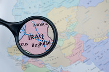 magnifying glass over a map of Iraq