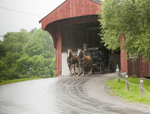 Amish carriage going through a covered bridge