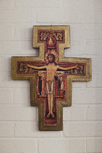 A piece of artwork in the shape of a cross - Depicting the crucifixion of Jesus