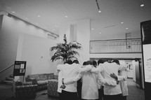 Groomsmen praying with the groom before the wedding
