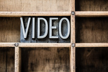 word video on a bookshelf