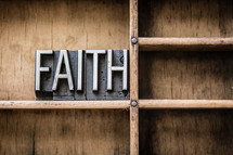 word faith on a bookshelf