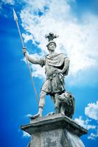 fierce warrior statue with lion