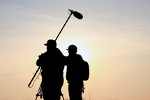 Silhouette of production assistants.