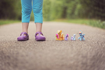 a child's feet and My Little Ponies