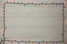 colored Christmas lights border.