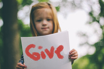girl holding give sign