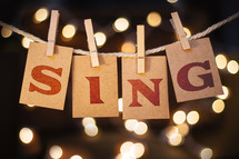 word sing hanging on clothes pins