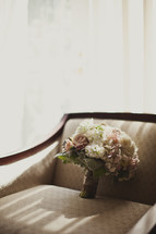 Bouquet of flowers resting on a chair
