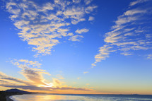 clouds in the sky at sunset over the ocean