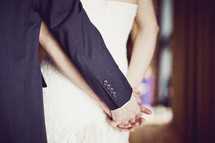 A wedding couple holding hands