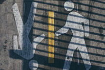 Pedestrian crossing symbol on asphalt