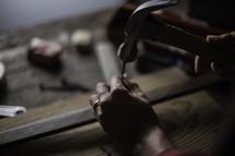 a man hammering a nail