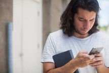 a man dialing on a cellphone