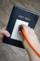 power of scripture - Bible with an outlet and power cord plugged in - get plugged in