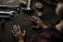 a man in his workshop with his tools