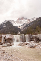 waterfall and snow on mountain peaks
