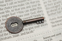 key on the pages of a Bible