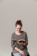 woman sitting and reading a Bible