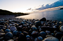 stones along a shore at dusk