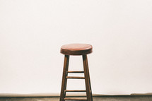 a stool in an empty room