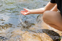 girl touching water
