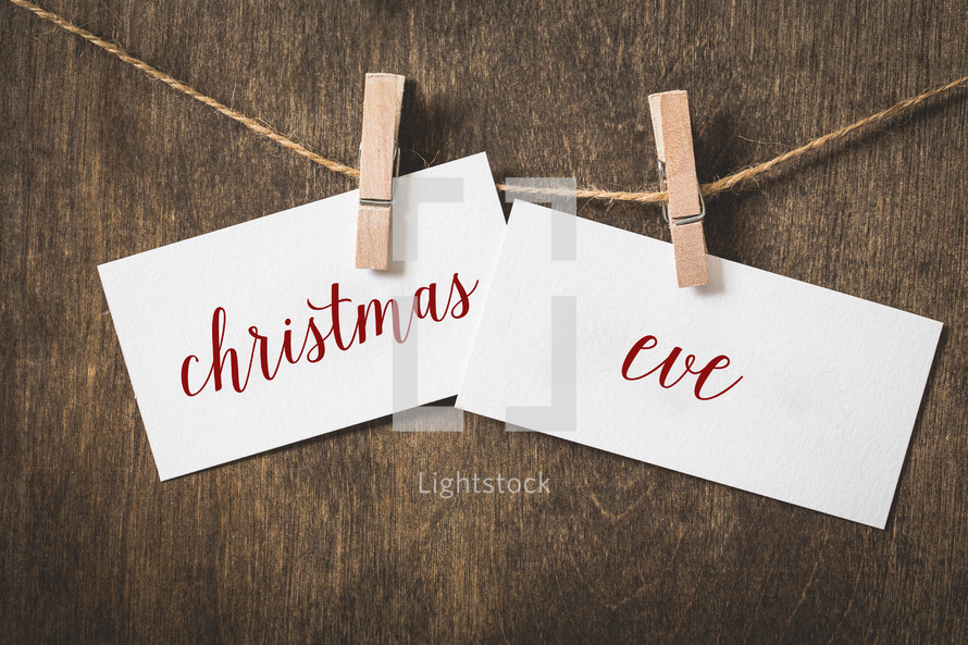 word Christmas Eve hanging on a clothesline