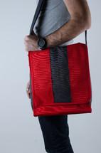 a man holding a satchel