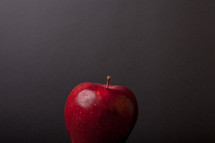 an apple against a blackboard