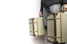 a man carrying luggage