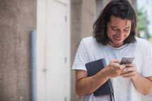 a man texting on a cellphone