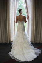bride standing in a window