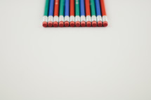 pencil erasers on white background