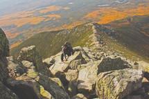 an adventurous man mountain climbing