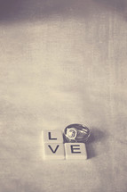 word love in wedding bands and scrabble pieces