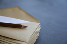 pencil on envelopes