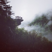 friends standing on a ledge