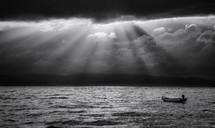 sunbeams on an empty boat floating in water