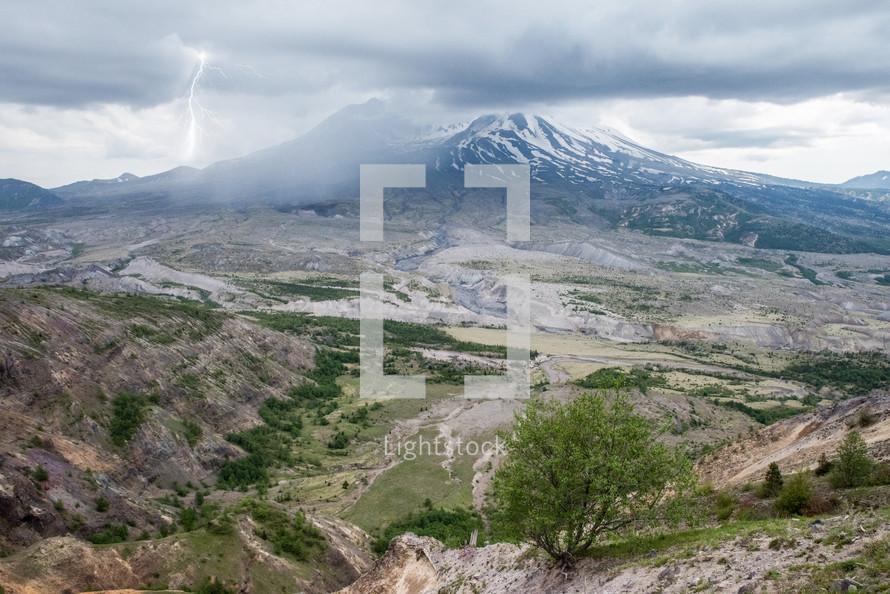 lightning striking a mountain peak