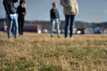 people standing in grass