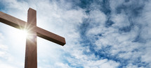 Christian worship and praise. Cross with sunset sky background. Easter.